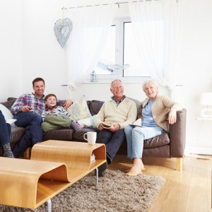 Photo of family watching TV